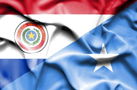 somalian culture: Waving flag of Somalia and Paraguay Stock Photo