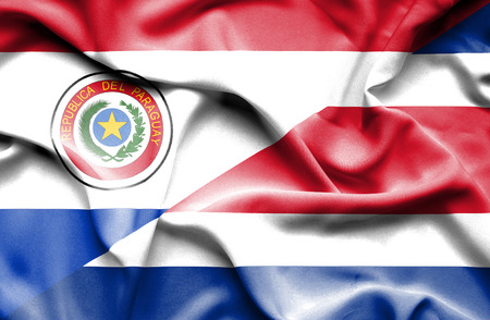 costa: Waving flag of Costa Rica and Paraguay Stock Photo