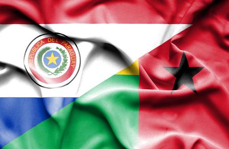 guinea bissau: Waving flag of Guinea Bissau and Paraguay Stock Photo
