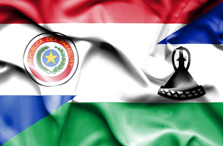 lesotho: Waving flag of Lesotho and Paraguay Stock Photo