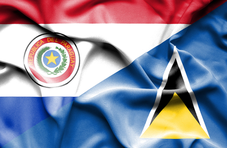 st lucia: Waving flag of St Lucia and Paraguay Stock Photo