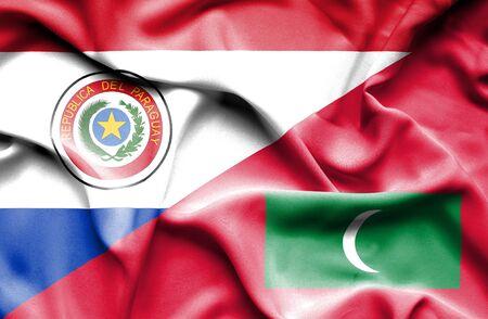 paraguay: Waving flag of Maldives and Paraguay