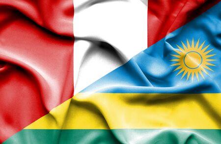 rwanda: Waving flag of Rwanda and Peru Stock Photo