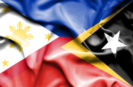 timor: Waving flag of East Timor and Philippines Stock Photo