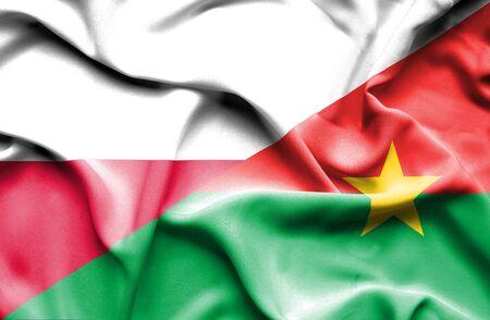 burkina faso: Waving flag of Burkina Faso and Poland Stock Photo