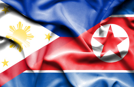 north korea: Waving flag of North Korea and Philippines