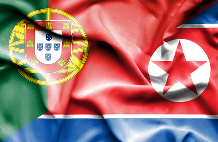 portugese: Waving flag of North Korea and Stock Photo