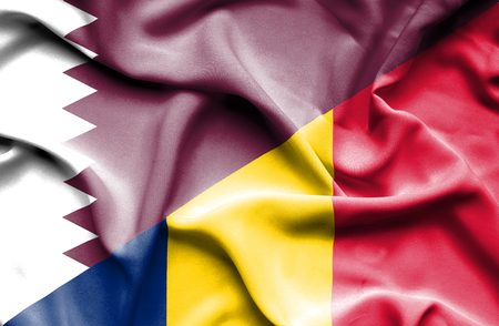 chad: Waving flag of Chad and Qatar Stock Photo