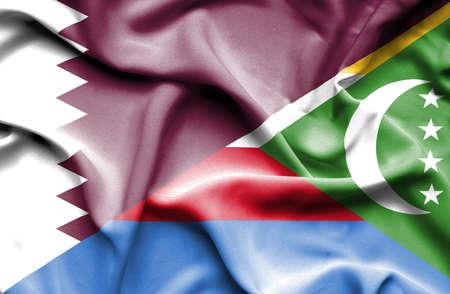 comoros: Waving flag of Comoros and Qatar Stock Photo