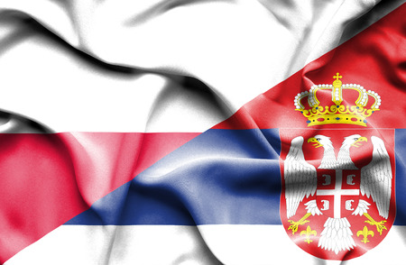 serbia: Waving flag of Serbia and Poland Stock Photo