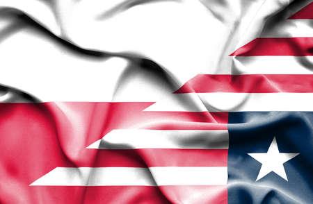 liberia: Waving flag of Liberia and Poland Stock Photo