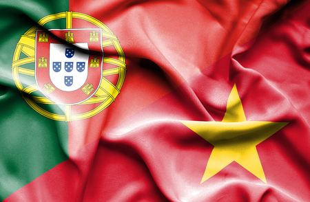 portugese: Waving flag of Vietnam and Stock Photo