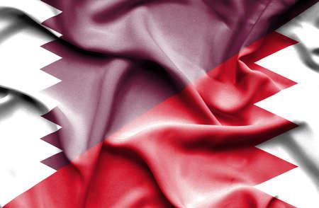 bahrain money: Waving flag of Bahrain and Qatar Stock Photo