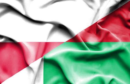 madagascar: Waving flag of Madagascar and Poland