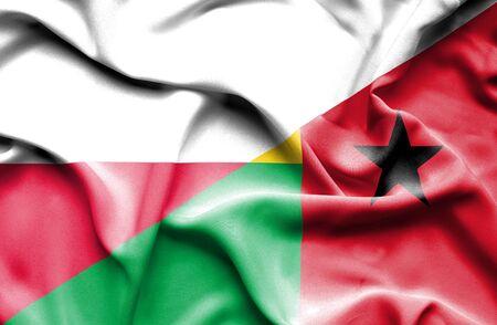 guinea bissau: Waving flag of Guinea Bissau and Poland