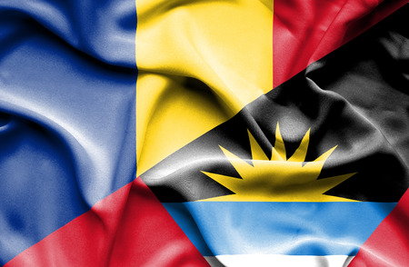 antigua: Waving flag of Antigua and Barbuda and Romania Stock Photo