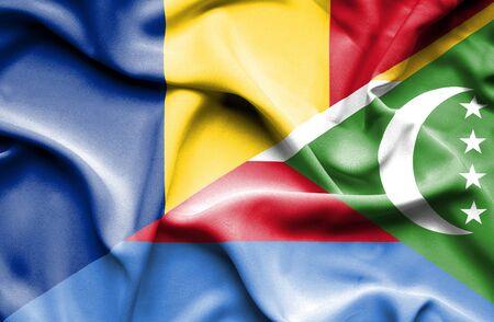 comoros: Waving flag of Comoros and Romania Stock Photo