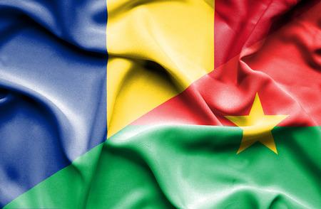 burkina faso: Waving flag of Burkina Faso and Romania Stock Photo