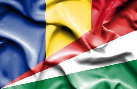 seychelles: Waving flag of Seychelles and Romania Stock Photo