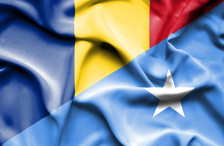 somalian culture: Waving flag of Somalia and Romania Stock Photo