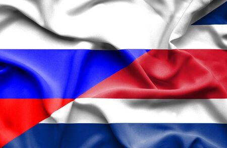 costa rica: Waving flag of Costa Rica and Russia Stock Photo