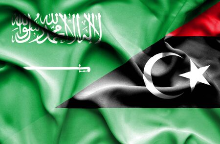 arabia: Waving flag of Libya and Saudi Arabia