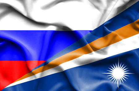 marshall: Waving flag of Marshall Islands and Russia Stock Photo