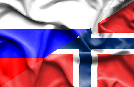 norway flag: Waving flag of Norway and Russia Stock Photo