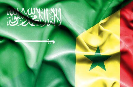 senegal: Waving flag of Senegal and Saudi Arabia