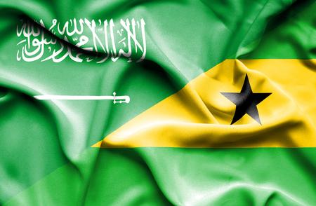 principe: Ondeando la bandera de Santo Tom� y Pr�ncipe y Arabia Saudita Foto de archivo
