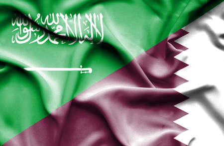arabia: Waving flag of Qatar and Saudi Arabia Stock Photo