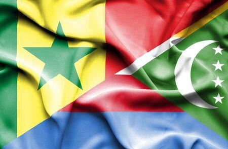 comoros: Waving flag of Comoros and Senegal Stock Photo