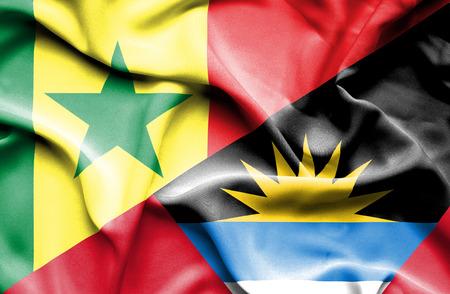 antigua: Waving flag of Antigua and Barbuda and Senegal Stock Photo