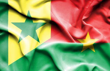 burkina faso: Waving flag of Burkina Faso and Senegal Stock Photo