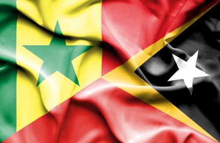 east: Waving flag of East Timor and Senegal
