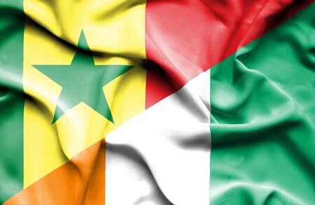 coast: Waving flag of Ivory Coast and Senegal