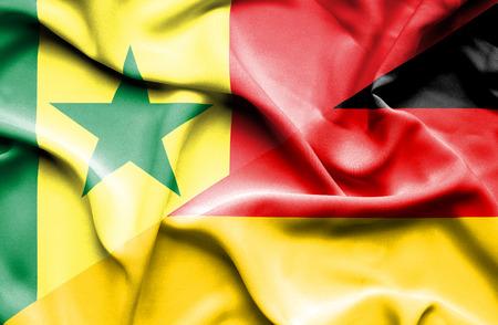 senegal: Waving flag of Germany and Senegal