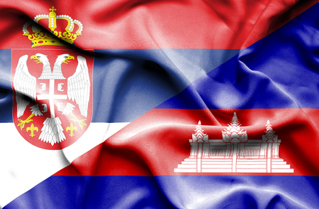 cambodian flag: Waving flag of Cambodia and Serbia Stock Photo