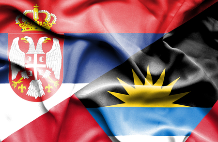 antigua: Waving flag of Antigua and Barbuda and Serbia Stock Photo