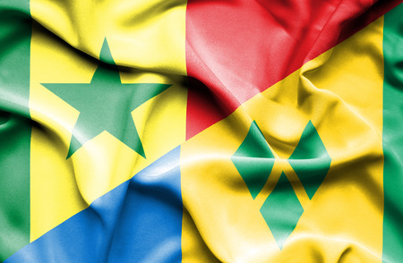 grenadines: Waving flag of Saint Vincent and Grenadines and Senegal