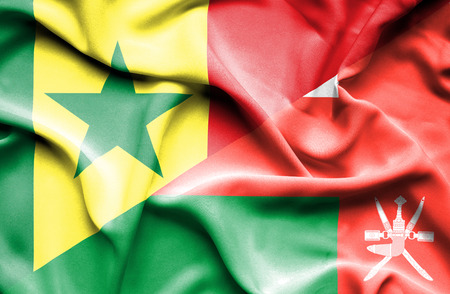 senegal: Waving flag of Oman and Senegal