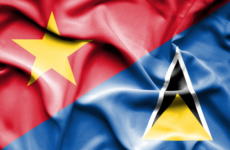 st lucia: Waving flag of St Lucia and Vietnam Stock Photo