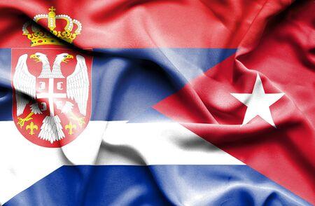 serbia: Waving flag of Cuba and Serbia Stock Photo