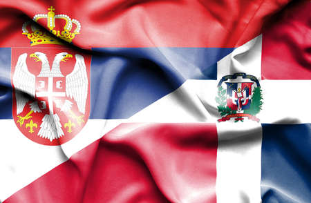 dominican republic: Waving flag of Dominican Republic and Serbia Stock Photo