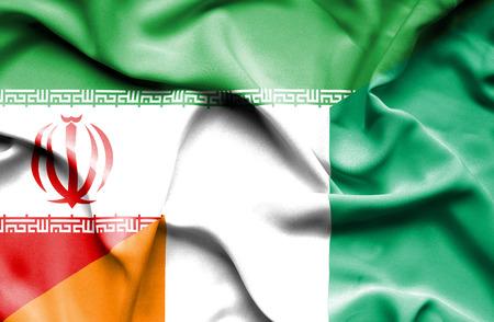 coast: Waving flag of Ivory Coast and Iran