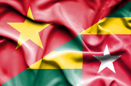 togo: Waving flag of Togo and Vietnam Stock Photo