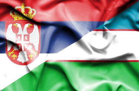 serbia: Waving flag of Uzbekistan and Serbia Stock Photo