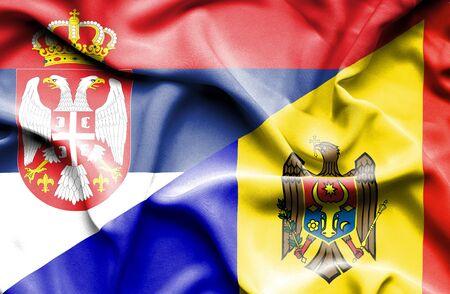 moldavia: Waving flag of Moldavia and Serbia Stock Photo