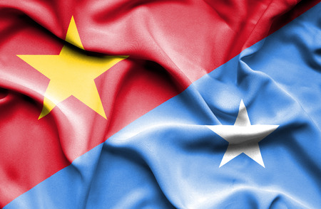 somalian culture: Waving flag of Somalia and Vietnam Stock Photo