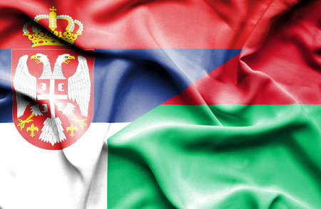 serbia: Waving flag of Madagascar and Serbia